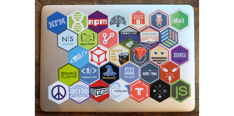 A laptop with many stickers of modular libraries