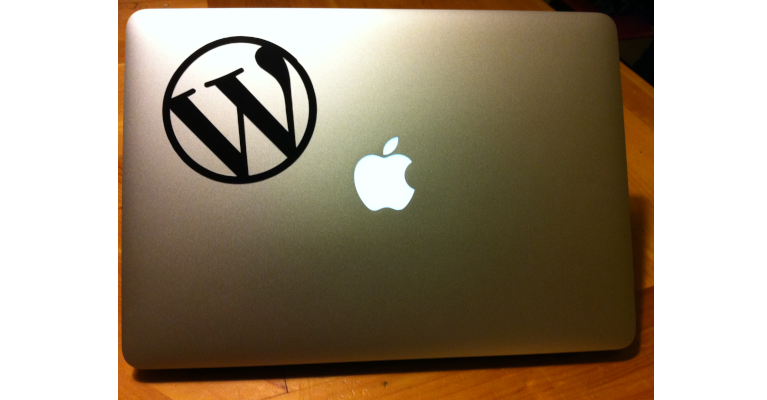 A laptop with one sticker, the WordPress sticker